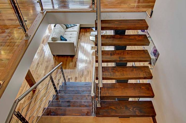 Stairs in a log home are very important. These ones are eye catching, gorgeous and fitting in this Timber Block Insulated Log Home.