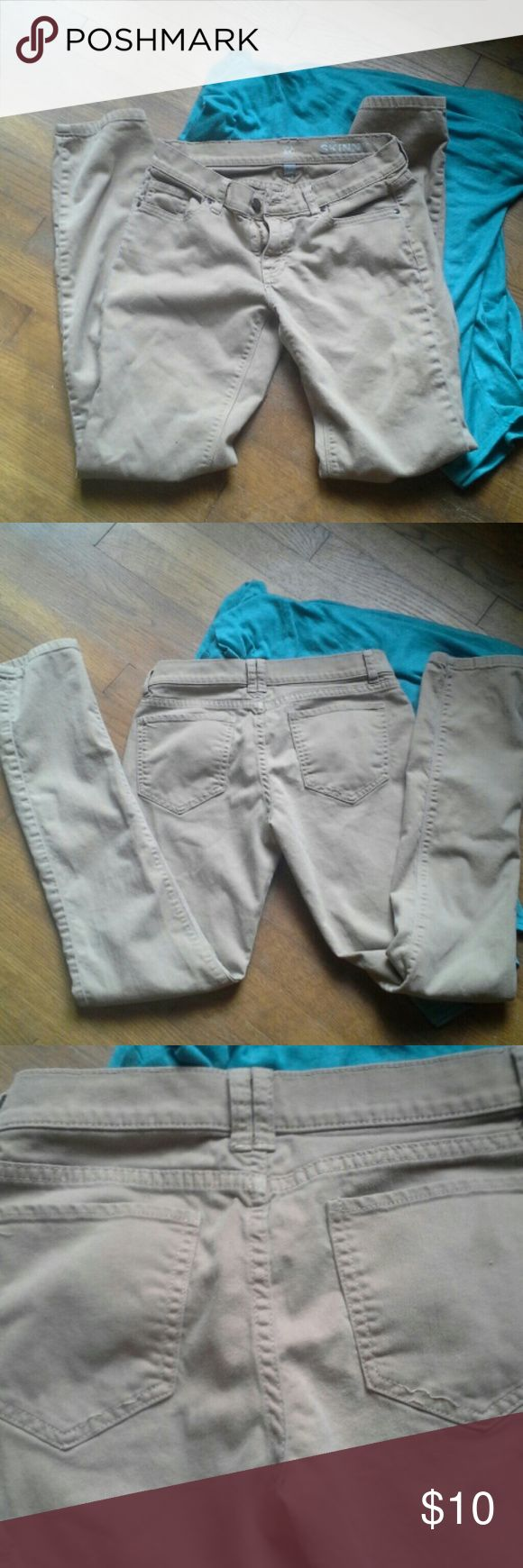 Tan skinny jeans Tan skinny jeans. Loose stitching on back pockets. A couple picks. New York & Company Jeans Skinny