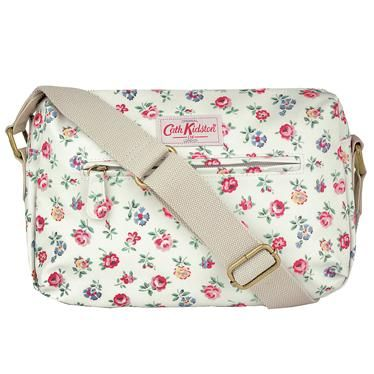 This deceptively spacious matt oilcloth double zip bag is perfect for everyday use, and is a great bag to take away with you too, owing to its wipe clean finish, secure zip fastenings and roomy main compartment. It features a handy front pocket, adjustable straps and leather trims and comes in a range of bright and beautiful prints.