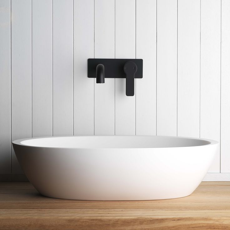 Pictured here is our Zeos Back Plate Basin Mixer in Switzrok Matte Black- a great contrast to the whitewashed panelling and our Silkstone Calais Basin. #faucetstrommen #faucet #basinmixer #backplatebasinmixer #matteblack #mattblack #blackbasinmixer #blacktaps #blacktapware #tapware #basin #stonebasin #interiordesign #bathroomdesign #scandinaviandesign #bathroom