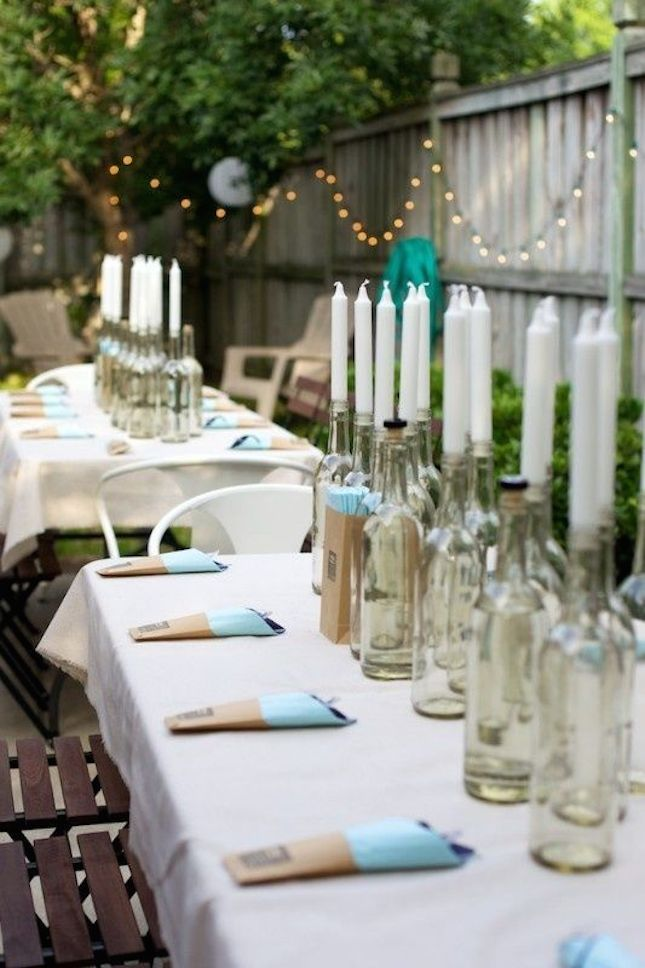 Use old wine bottles to DIY this tablescape.