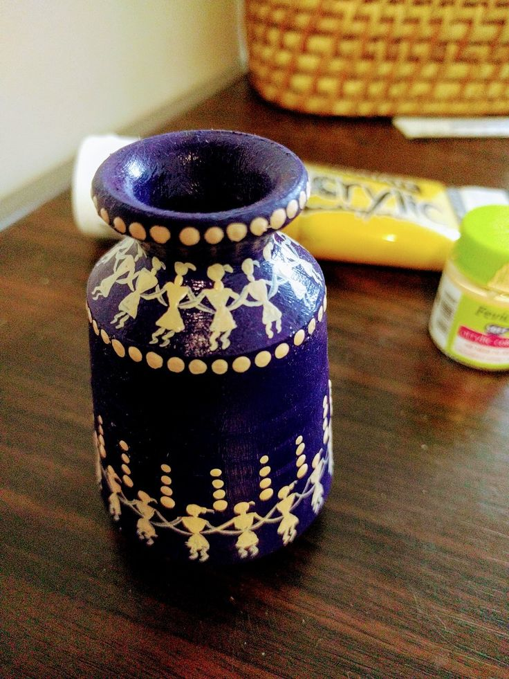 Miniature mud pot with worli painting