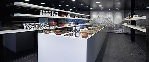 Wilsonart black and white Aeon laminate brings design and performance at its best. This confectionery commercial store brings design to a whole new level.