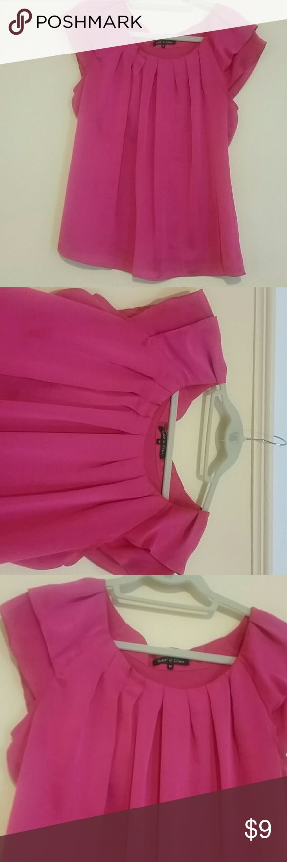 Cap sleeve hot pink blouse Easy to wear hot pink cap sleeve blouse. Pleated detail at neckline. Pretty & delicate. 100% polyester,  feels like silk. Great for work or play! Violet & Claire Tops Blouses