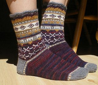 A top down sock with colorwork. Yardage in this pattern is deceptive since you will only use smaller amounts of the contrasting colors.
