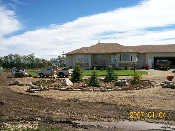 Still Under Construction, But A Simple Front Yard Circular Driveway Idea In  A Country Setting. Large Border Stones Placed Around A Perimeter Of Mulch  Over ... Part 67