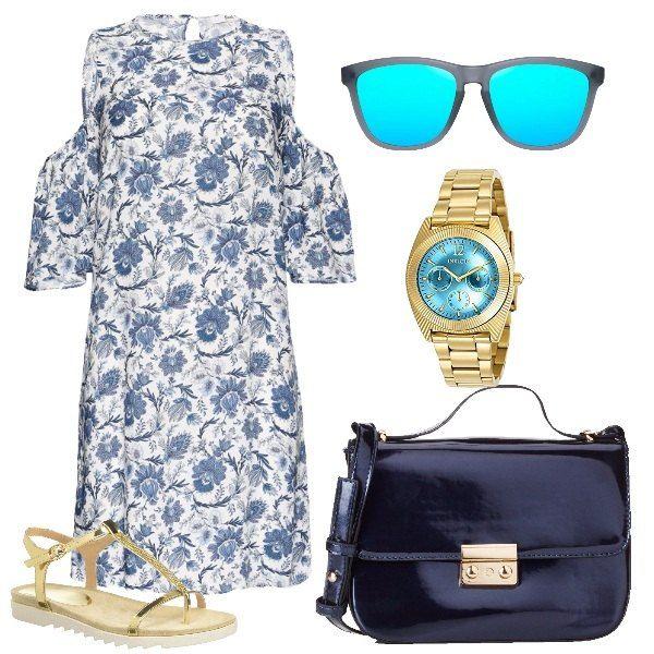 Il vestito corto bianco a fiori blu ha uno scollo alto, una linea a trapezio e spalle scoperte con maniche a 3/4 staccate. Lo abbiniamo a dei sandali bassi dorati con strisce essenziali e para bianca. Come borsa una tracollina in vernice blu con dettagli dorati. Per finire orologio in acciaio dorato con sfondo dello schermo azzurro cielo e occhiali da sole con montatura bianco giacchio e lenti azzurre specchiate.