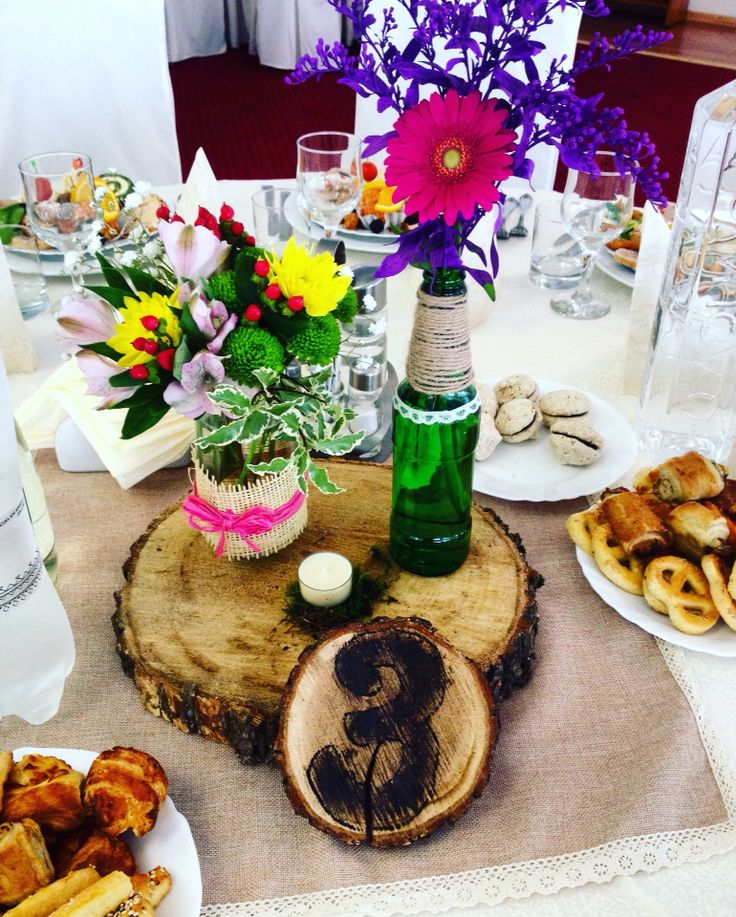 Rustic wedding flowers design with beer bottles, mason jars, wood by Atelier Floristic Aleksandra concept Alexandra Crisan