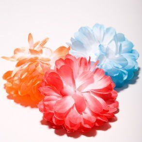 Flower Hair Clips by Century Novelty. $1.95. Dress Your Luau Party Guests in Something Different! This Flower Hair Clips are an attractive addition to your Luau party at an affordable price that keeps your check book as happy as your Luau guests. And since a tropical party is not complete until everything is Hawaiian, including the guests, these hairclips are the perfect luau or mermaid costume accessory. Two hairclips per package. Assorted colors. Clips are made of plasti...