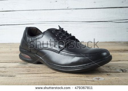 Men shoe on old wooden table