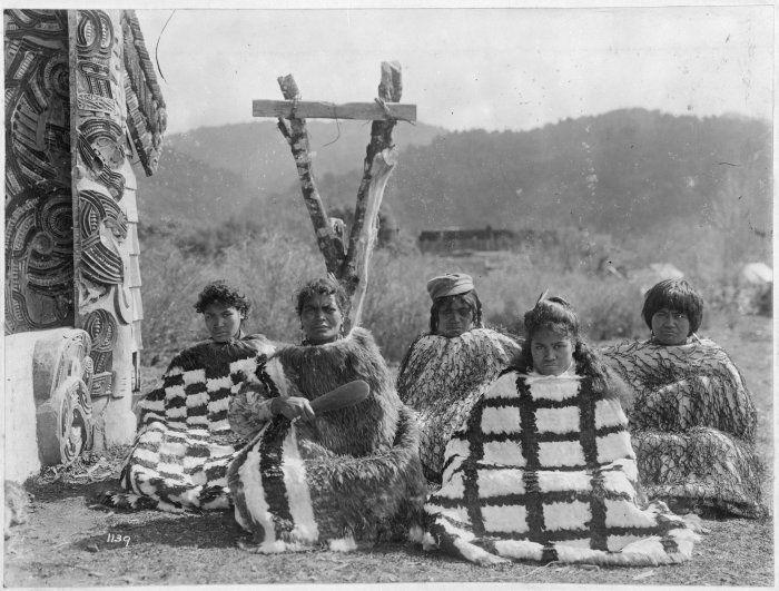 Maori women wearing Kahu huruhuru (feather cloaks) and korowai (tag cloaks), seated outside Te Whai-a-te-Motu meeting house at Mataatua. The woman holding the patu is the wife of Te Whenuanui II. Taken by an unidentified photographer, circa 1910's. ~ They look pretty fierce (esp. the second woman from the right)!
