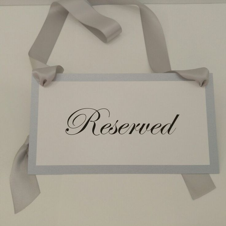 #wedding pew sign prepared with shimmery silver card stock and silver ribbon. Silver is the perfect neutral if you're struggling to coordinate colors.