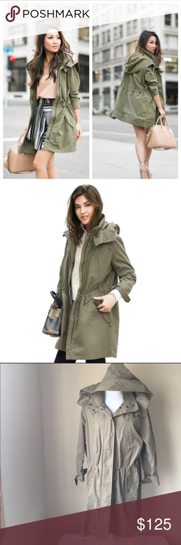 "Banana Republic Oversized Military Parka My pics make it look beige but it's the olive color that is shown in the first two pics 👍🏽 Right in step with the military trend, our parka boasts an oversize, relaxed silhouette. Standing collar with snap closure. Hooded. Long sleeves with snap cuffs. Full zip and snap closure. Front exterior pockets. Elasticized waist. Body length: 37"". Model is 6'. Banana Republic Jackets & Coats Utility Jackets"