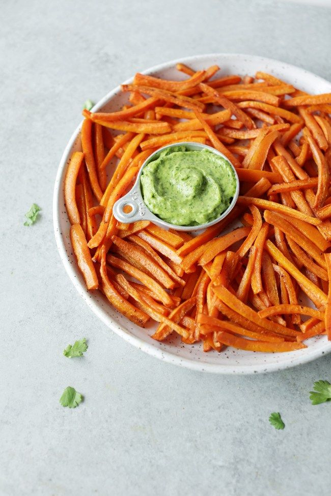 No guilt baked carrot fries with creamy avocado chimichurri dipping sauce! Healthy, so delicious and perfect as an easy side dish or snack!