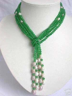 Image from http://cdn.iofferphoto.com/img3/item/139/912/423/stunning-white-pearl-jade-necklace-e4ae5.jpg.