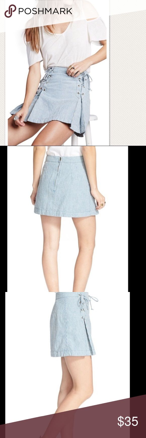 NWT Free People Railroad Striped Mini Skirt Flirty lace-up detailing accents the dimensional front pleats of a sunshine-ready miniskirt crafted from a breezy, railroad-striped blend of cotton and linen. Lined. 55% cotton, 45% linen. #108 Manufacturer: Free People Size: 6 Size Origin: US Manufacturer Color: Blue Combo Retail: $88.00 Condition: New with tags Collection: Free People Bottom Closure: Exposed Back Zipper Length: Mini Total Skirt Length: 15 1/2 Inches Waist Across: 14 Inches Hips…