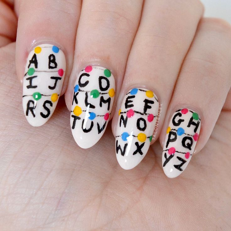 Stranger Things Nail Art To Celebrate Season 2 // -Are you just as excited about heading back to the Upside Down for season 2? This Stranger Things nail art is just for you...