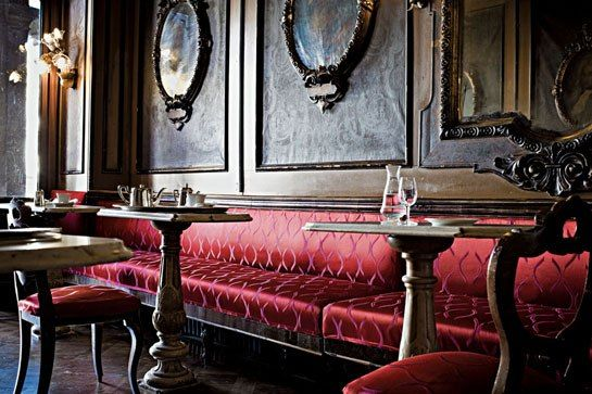 Caffè Florian in Venice, Italy's oldest café, makes stunning use of Rubelli's Basegio damask in rich carmine on its banquettes. Photo: Federico Cedrone