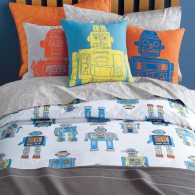 Robots are always cool. He does have a bunk bed. Maybe we could get 2 different bedding sets.
