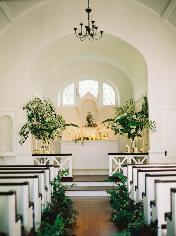 Free form ceremony arrangements with lots of candles;  florals by Nature Composed Sweet Southern Charm