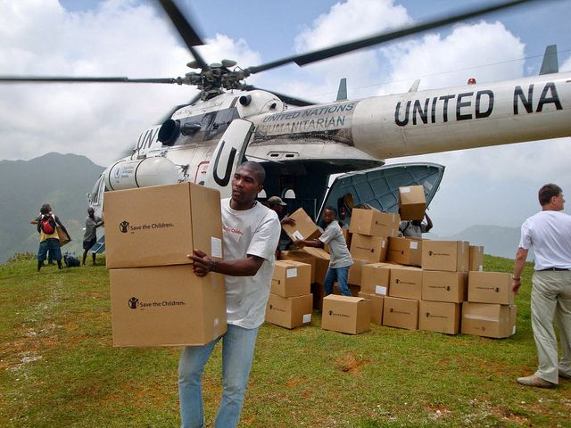 Relief supplies are distributed in a rural and hard-to-reach section of Leogane, Haiti. Photo by Save the Children. #savethechildren #emergency #relief #support