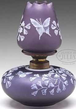 lighting, England, An English Cameo glass miniature oil lamp, shade having white cameo decoration of ivy and branches on an amethyst background with a cameo betterfly. Matching base has same decoration with two butterlies and original metal hardware. Circa 1801-1900
