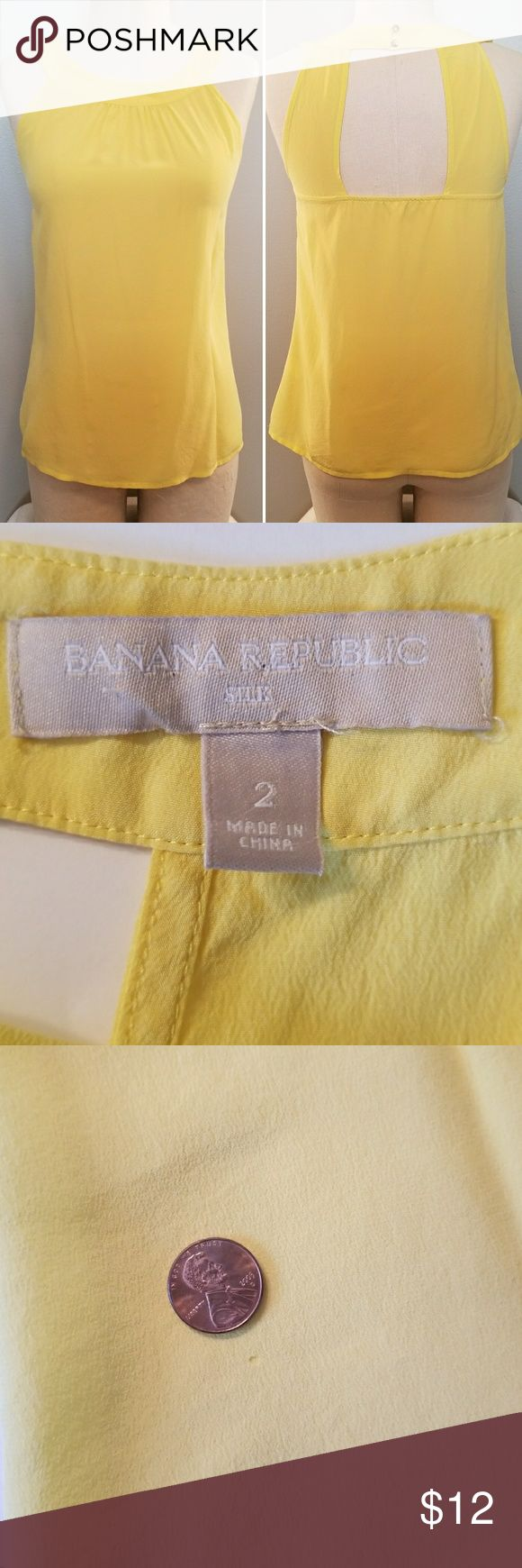 BananaRepublic sleeveless silk blouse This lovely canary yellow silk top is slightly sheer, runs true to size and is perfect for spring or laying for cooler weather. Pure silk. Has an almost imperceptible pin size hole shown in 3rd picture. Priced accordingly Banana Republic Tops Blouses