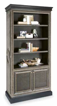The Marielle bookcase from Century Furniture ...a fully customizable upholstered exterior is trimmed with nailheads. Three open, adjustable wood shelves above two doors that hide an adjustable interior shelf. Dark antique brass hardware tops it off.