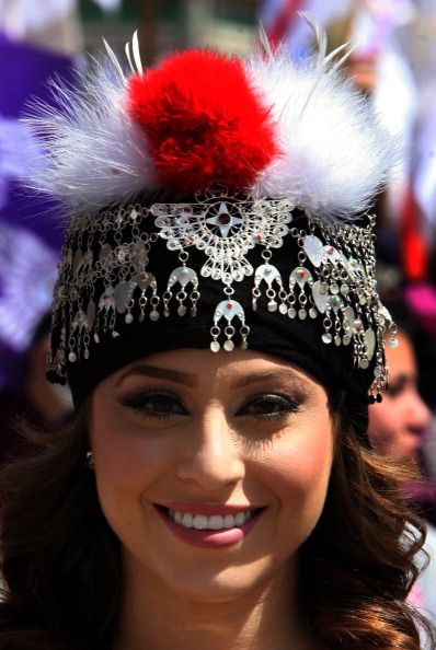 An Iraqi Christian Assyrian woman wearing a traditional headdress celebrates their New Year (Aketo) in the northern Iraqi city of Dohuk, 500 kilometres north of the capital Baghdad, on April 1, 2013. Descendants of Iraq's ancient Assyrians are enjoying the start of parties and parades to celebrate their New Year, a pagan rite that glorifies resurrection and life and dates back millennia. SAFIN HAMED/AFP/Getty Images