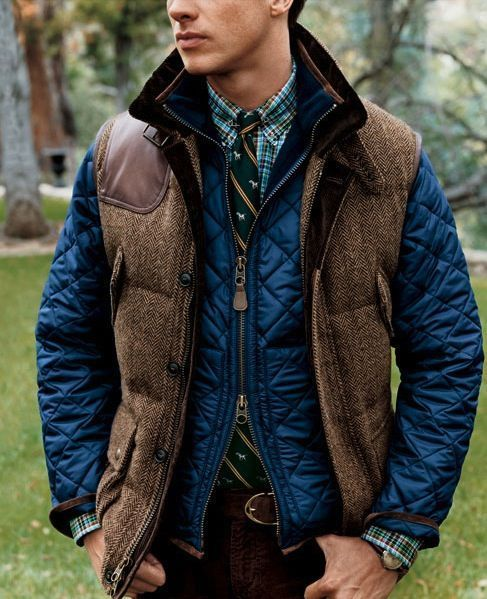 Choose a navy quilted bomber jacket and burgundy chinos for a casual level of dress.  Shop this look for $178:  http://lookastic.com/men/looks/chinos-and-belt-and-longsleeve-shirt-and-tie-and-bomber-jacket-and-gilet/4048  — Burgundy Chinos  — Dark Brown Leather Belt  — Green Plaid Longsleeve Shirt  — Teal Vertical Striped Tie  — Navy Quilted Bomber Jacket  — Brown Wool Gilet