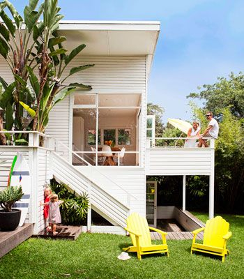 1950's renovated house in Sydney, Australia.  sundrenched beach cottage, with open air walls lotta white, but has warm comfortable furnishings.