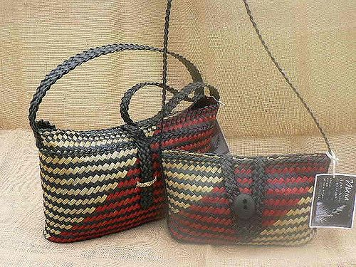 Harakeke (flax) kete with flat bottoms and flat woven handles.  Small kete has small stone toggle