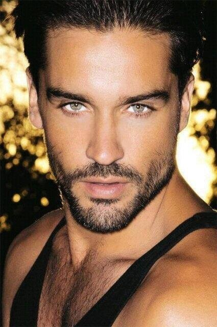 Sexy hunky male model with beautiful green eyes and sexy facial hair