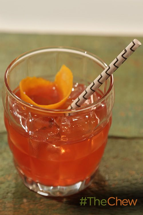 This Bloody Orange Bourbon fizzy cocktail is the perfect addition to your spooktacular Halloween party!