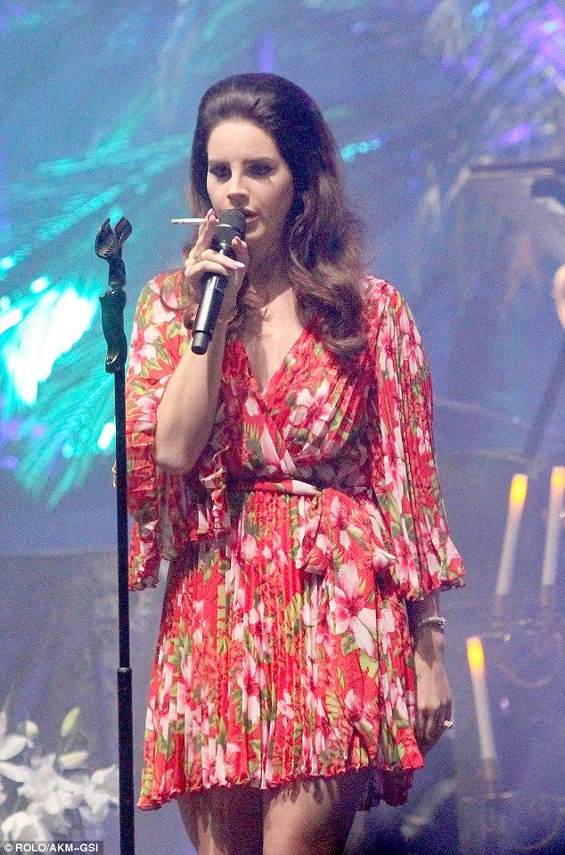 Nicotine fix: Lana Del Rey puffed on a Camel cigarette onstage her sold-out Hollywood Forever Cemetery concert in Los Angeles Friday