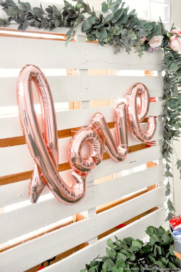 "Bridal shower decor idea - outdoor brunch bar with rose gold ""Love"" balloons {Courtesy of Kara's Party Ideas}"