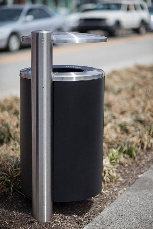 Custom 30-gallon pole-mount Litter and Recycling Receptacle shown with stainless steel lid and pole, custom graphics, and body in Black Texture Powdercoat at Penn Avenue, Pittsburgh, Pennsylvania