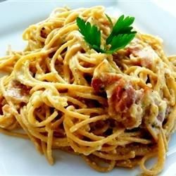 Spaghetti alla carbonara in its authentic form: peppery, creamy without using cream, cheesy, and delicious.