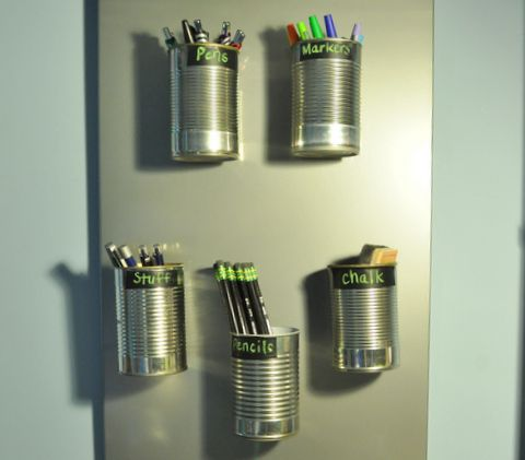 For his supplies, I hot glued a few magnets to the back of veggie and soup cans and stuck them on a magnetic board from Ikea. I used chalkboard contact paper as labels.