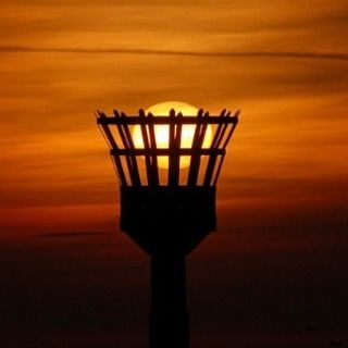In light of the Warriors Cavaliers NBA game tonight what better way to shine it upon them then this photo a basketball  sun going down into the basket. Score 1 for the universe. #basketball #sunset #sunlight #evening #gamenight #clevelandcavaliers #oaklandwarriors #nba