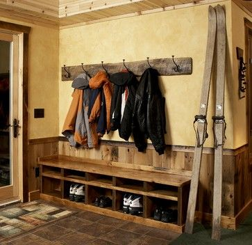 rustic cabin entryway with reclaimed wood coat rack.