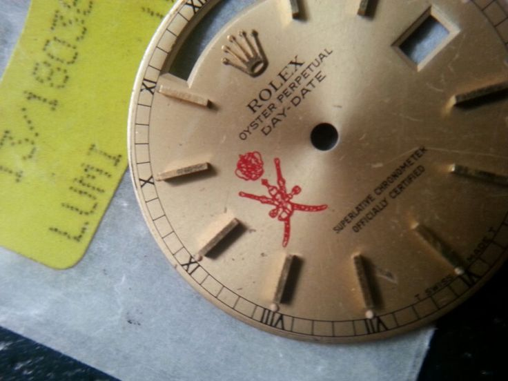 Day date rolex dial oman crest
