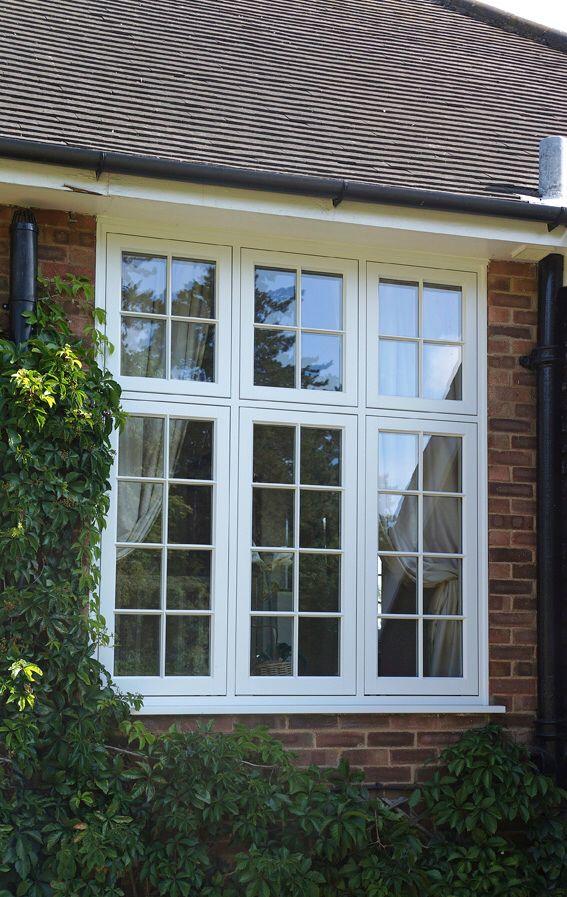 Large triple casement window with fanlights