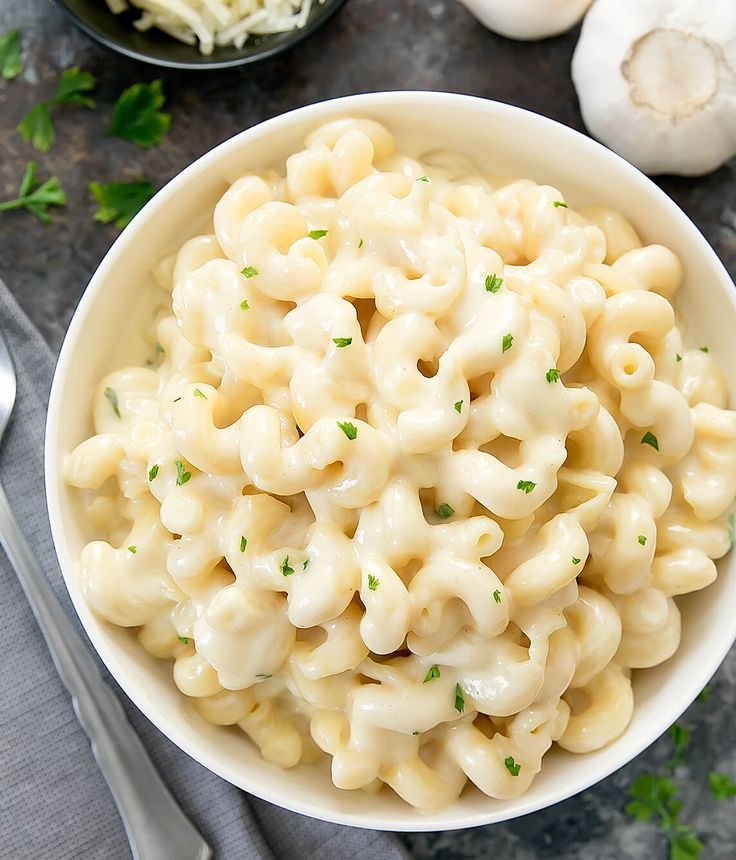 This super creamy macaroni and cheese is flavored with garlic and parmesan cheese. It is a more grown-up version of macaroni and cheese, but just as easy to make as the classic.