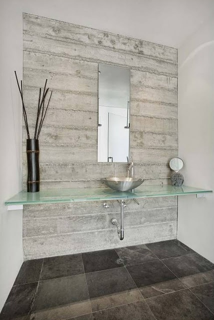 Minimalist design has been softened with the rich dark coloured floor tiles and the feature wall behind the 'vanity'.