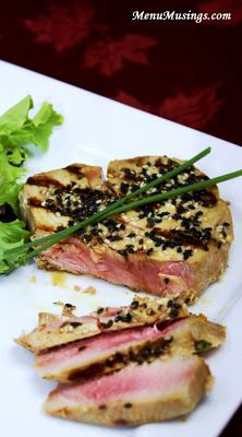 Seared Marinated Tuna Steaks - Yes, we love grilled tuna steaks! One of the best sources of lean protein out there that can essentially be a blank slate for flavors. For this recipe, we marinated the steaks in an Asian inspired sauce that will both flavor and further tenderize the meat. The key to a great tuna steak is to cook it as a medium-rare steak, as overcooking will produce a tough dry fish. I adapted this recipe from Anne Burrell's recipe on Food Network.