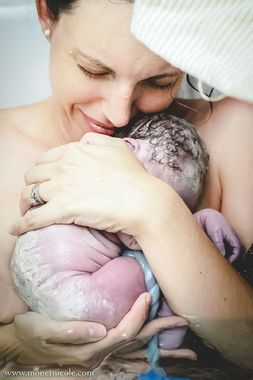 Together -- at last. Birth photo series by Monet Nicole Moutrie captures the unsung hero of new life: the umbilical cord.