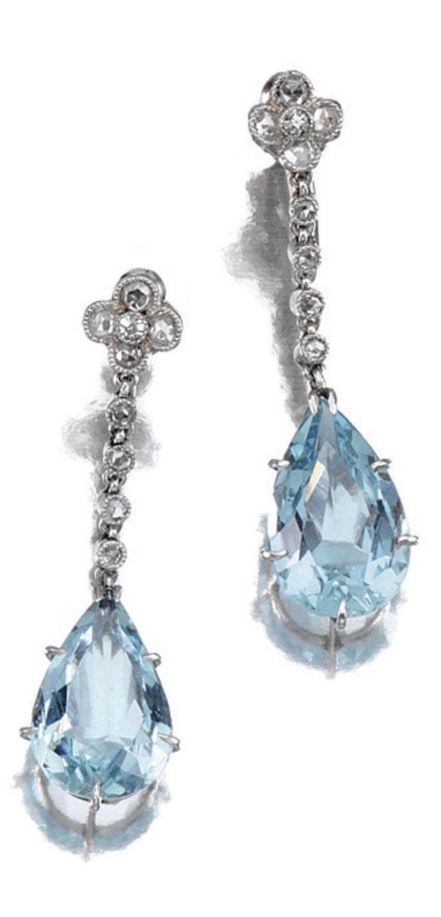A PAIR OF BELLE EPOQUE AQUAMARINE AND DIAMOND EARRINGS, 1910S. Each millegrain-set with single- and rose-cut diamonds, to a surmount of quatrefoil design, suspending a pear-shaped aquamarine drop, screw back fittings. #BelleÉpoque