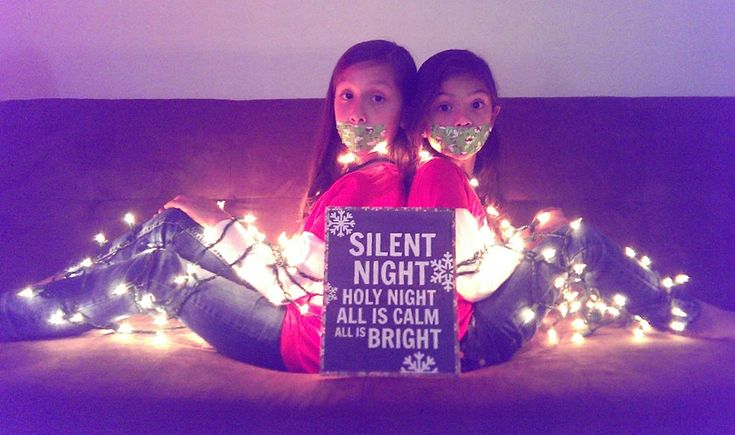 Our photo Christmas card -- the girls duct taped with holiday reindeer and bound with string lights, and the perfect facial expressions.  #humor #silent #night #funny