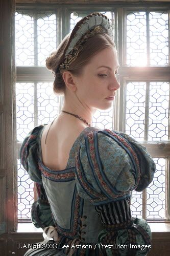 Trevillion Images - beautiful-medieval-tudor-woman-by-window